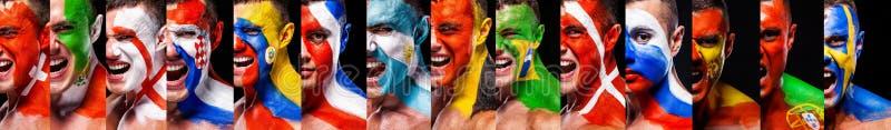 Cara do close up do futebol ou dos fan de futebol com bodyart na cara com emoção da agressão Bandeiras de país fotografia de stock royalty free