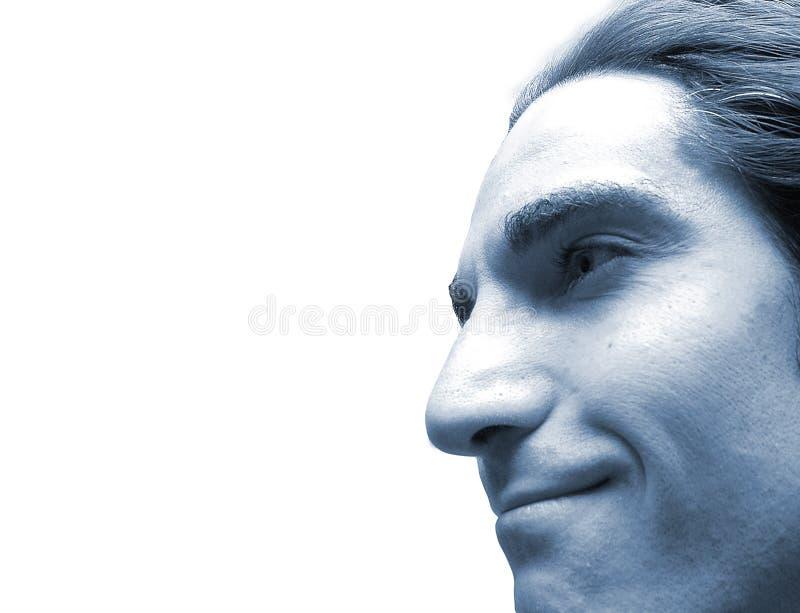 Cara en azul foto de archivo