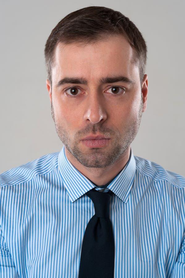 Cara enojada del hombre de negocios imagen de archivo