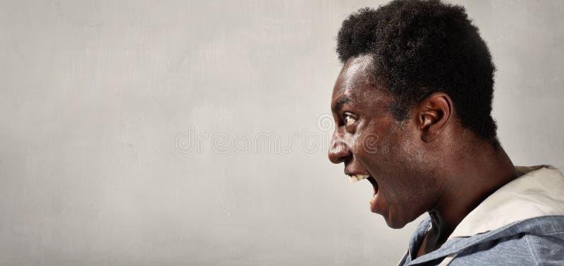 Cara enojada del hombre negro imagen de archivo