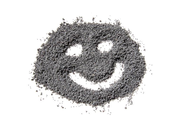 Cara feliz feita das sementes de papoila secadas fotografia de stock