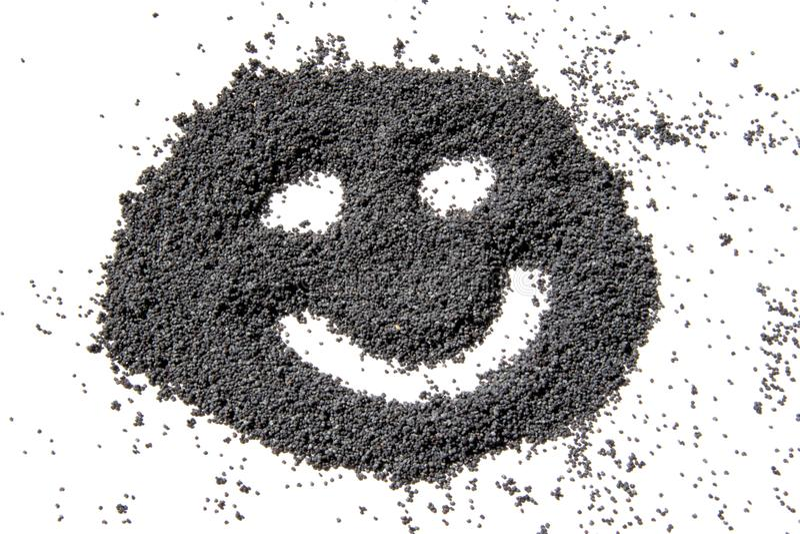 Cara feliz feita das sementes de papoila secadas imagens de stock