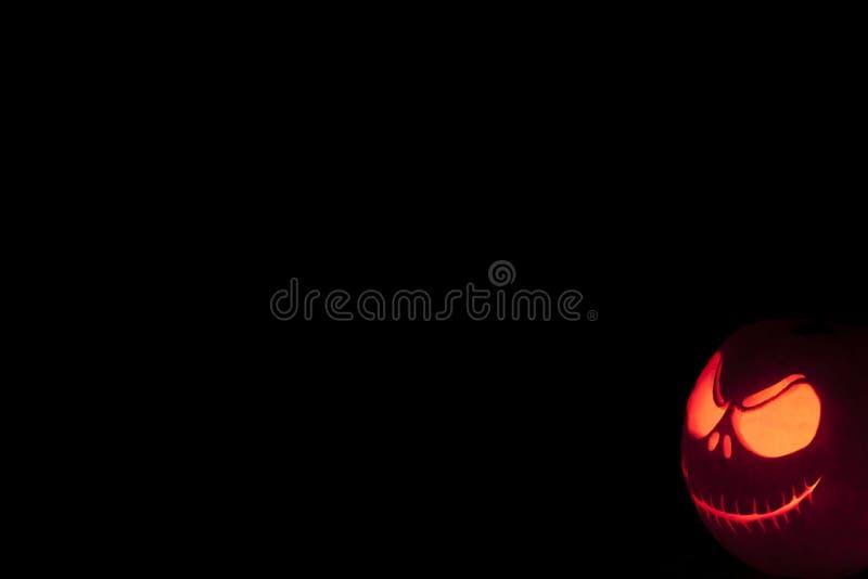 Cara grimming de la calabaza de Halloween pescada con caña imágenes de archivo libres de regalías