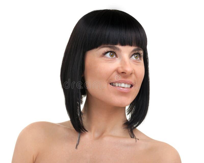Cara hermosa del cierre de la mujer joven para arriba, aislada en el fondo blanco fotografía de archivo libre de regalías