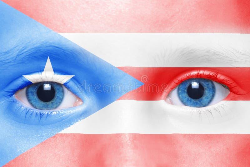 Cara humana del ` s con la bandera de Puerto Rico fotos de archivo
