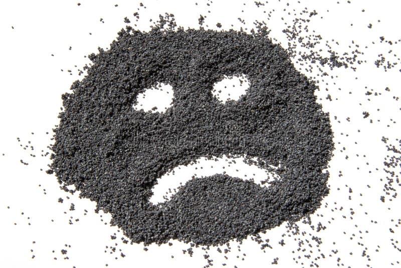 Cara infeliz feita das sementes de papoila secadas fotografia de stock