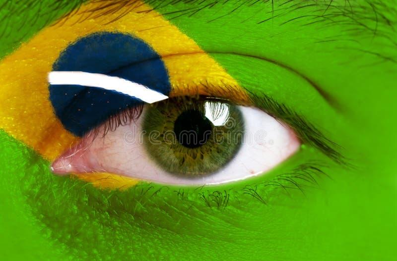 Cara pintada com a bandeira de Brasil fotografia de stock