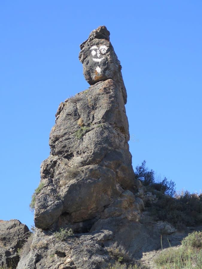 Cara pintada de la roca fotografía de archivo libre de regalías