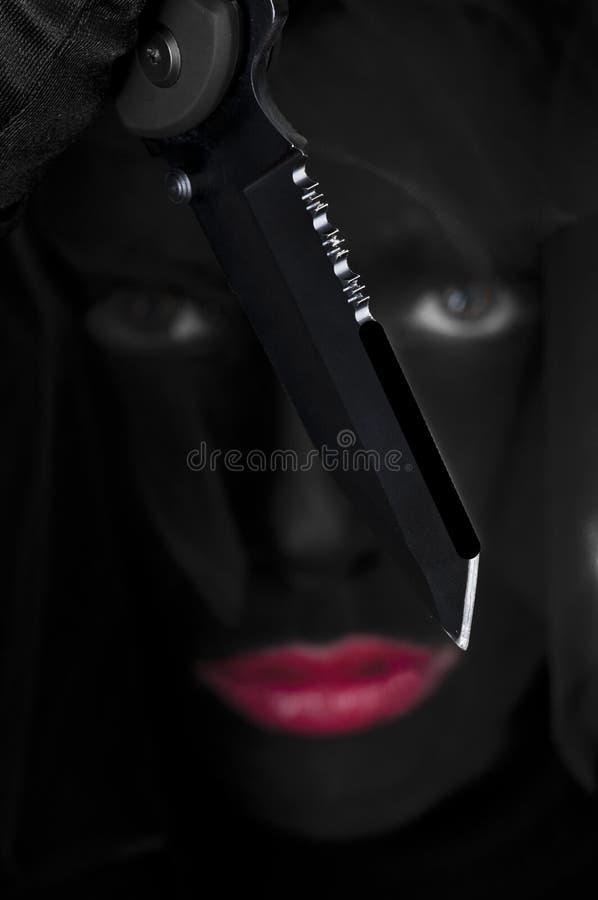 Cara pintada negro - asesino foto de archivo