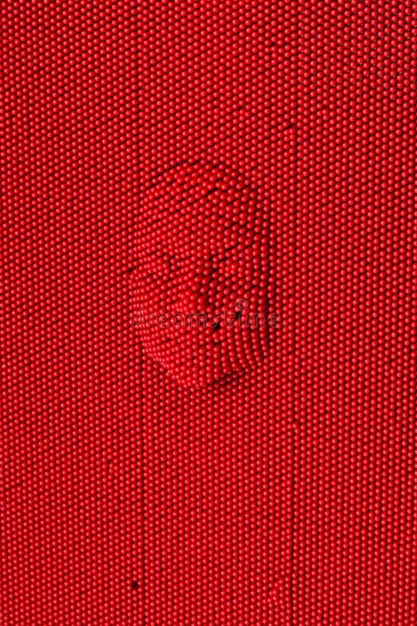 Cara presionada al tablero rojo del arte del perno foto de archivo libre de regalías