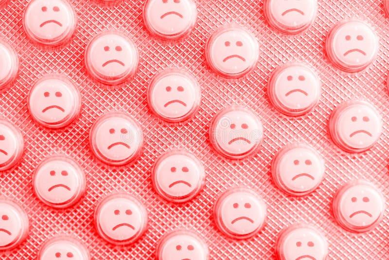 Cara triste dos comprimidos foto de stock