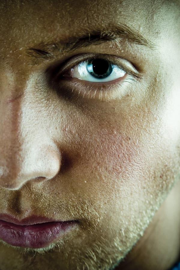 Cara y ojo del hombre joven foto de archivo