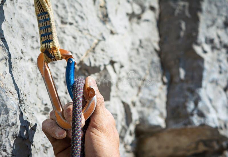 Carabiner and climbing rope stock photos