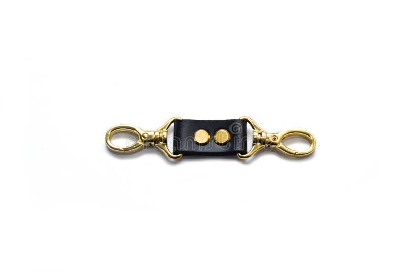 Carabiner dorato del metallo isolato su fondo bianco adattare immagini stock libere da diritti