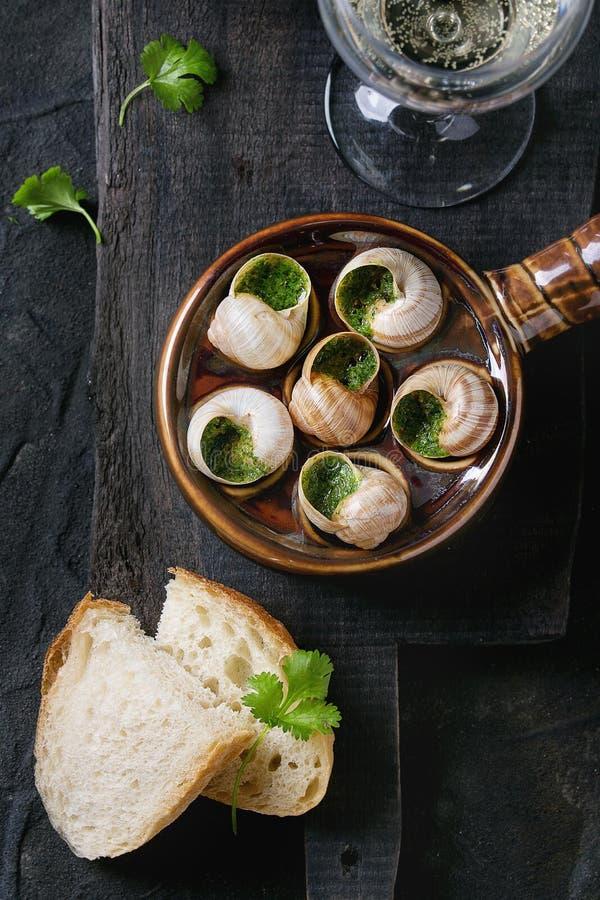 Caracóis prontos para comer de Escargot de Bourgogne foto de stock royalty free