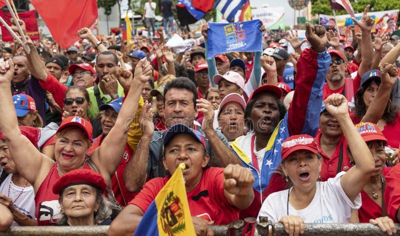 caracas Марш демонстрантов в поддержку измерений правительства новых экономических стоковые изображения rf