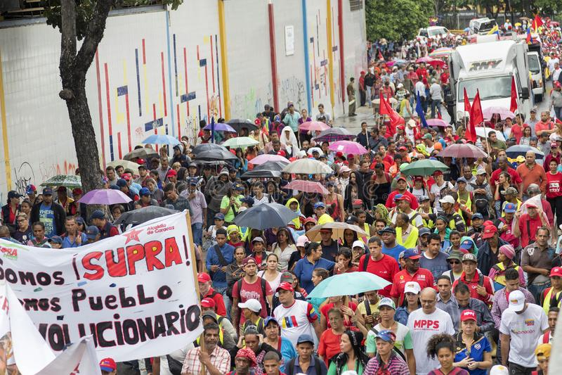 caracas Marzo dei dimostratori a sostegno di nuove misure economiche di governo fotografie stock
