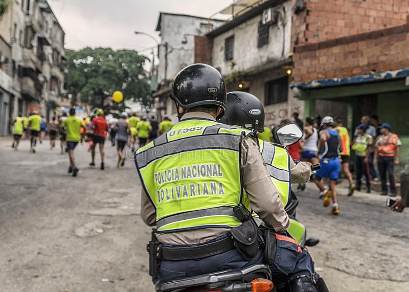 Caracas, Venezuela - April 24, 2016: Police taking care of marathon runners at CAF Marathon 42K. stock photo