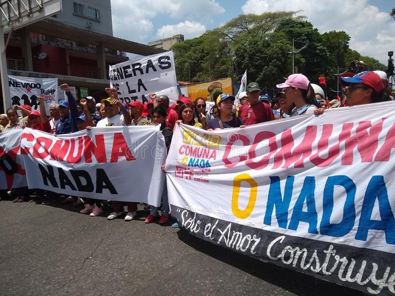 Supporters of Nicolas Maduro march in Caracas to  commemorate the first anniversary of reelection stock image