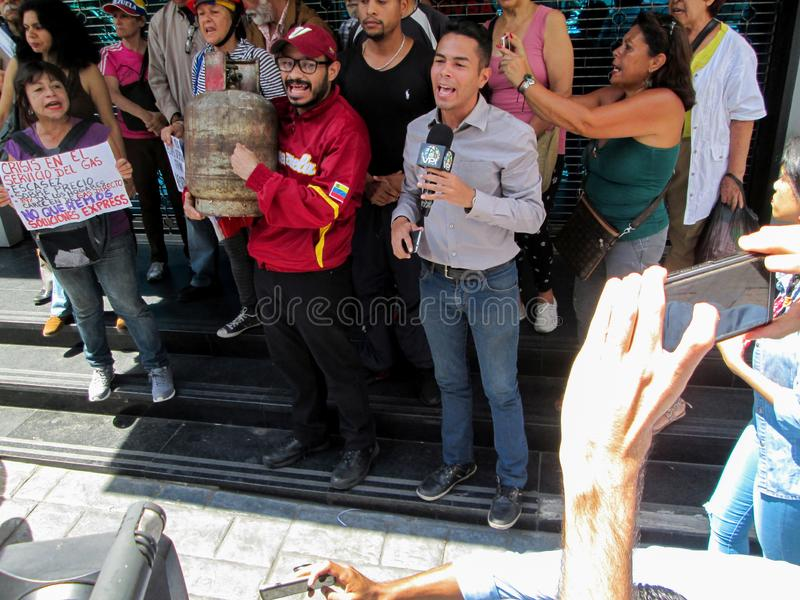 Caracas, Venezuela.Protest of citizens of Caracas for inefficiency in the domestic gas service at the gates of PDVSA GAS.  stock photography