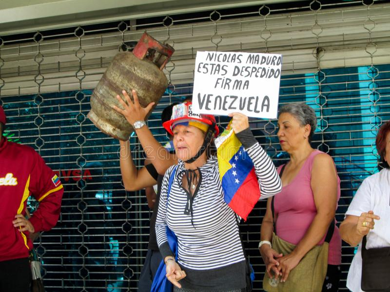 Caracas, Venezuela.Protest of citizens of Caracas for inefficiency in the domestic gas service at the gates of PDVSA GAS.  royalty free stock images