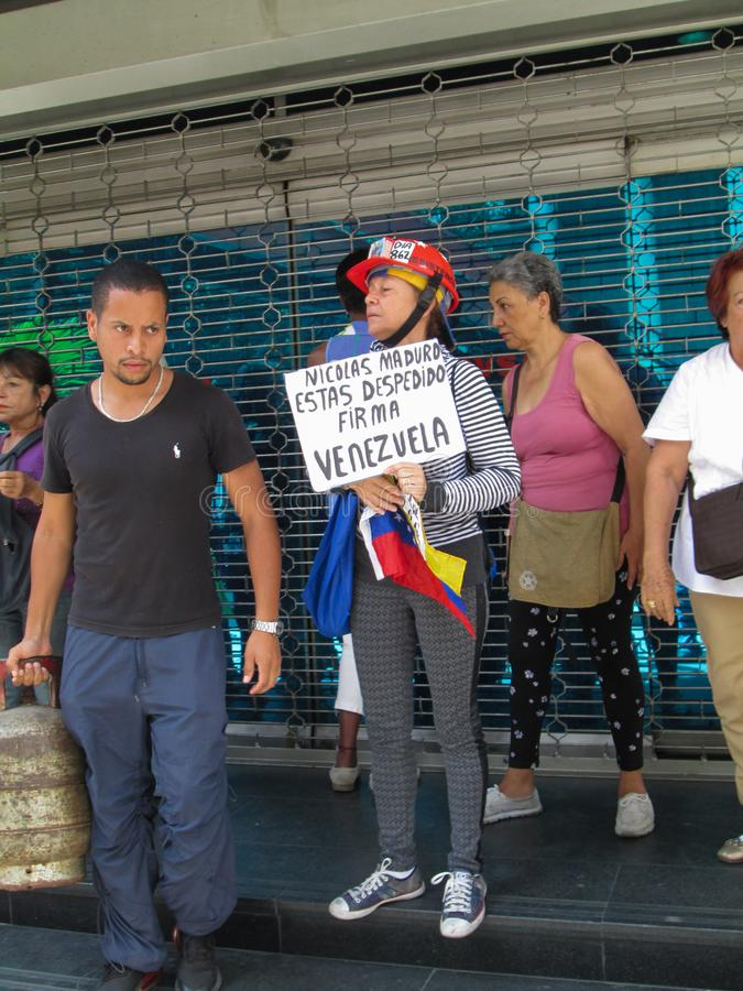 Caracas, Venezuela.Protest of citizens of Caracas for inefficiency in the domestic gas service at the gates of PDVSA GAS.  royalty free stock photography