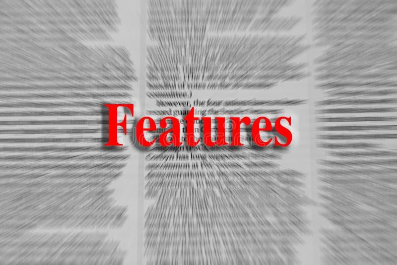 Características escritas no vermelho com um artigo de jornal borrado foto de stock royalty free