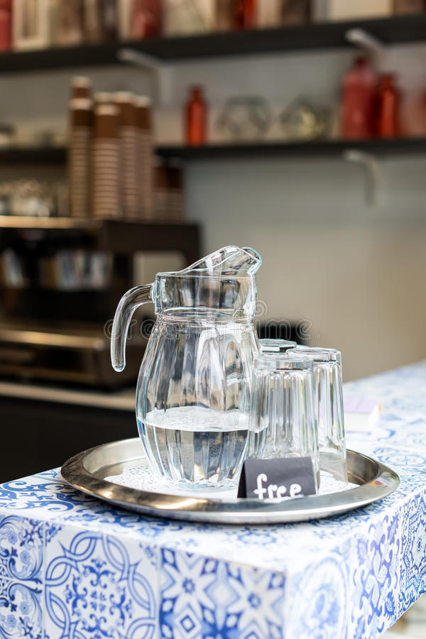 Carafe with free water in cafe. Carafe with free cold water in cafe stock photos