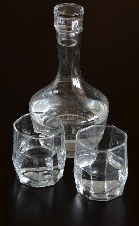 Carafe with glasses. Glass carafe with water and two glasses royalty free stock image