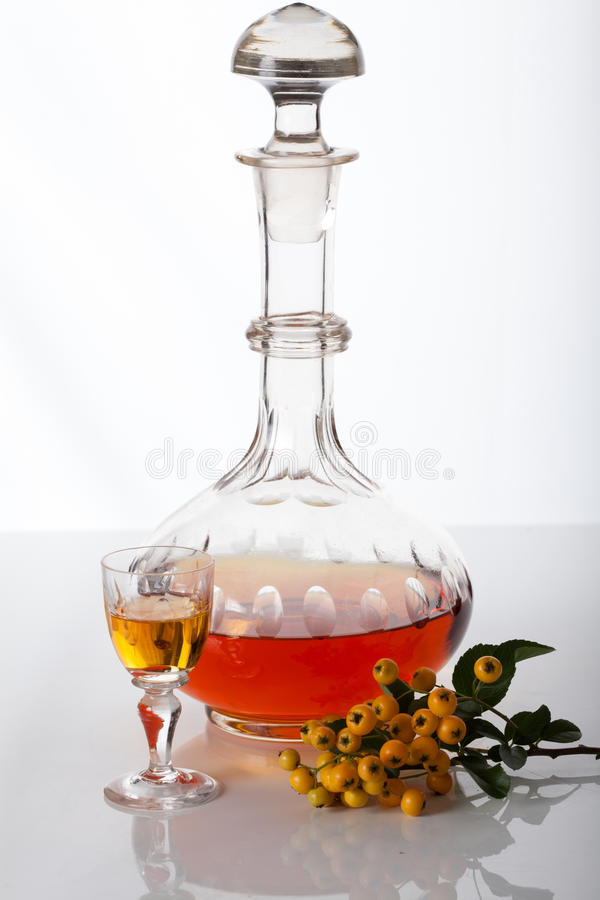 Carafe with homemade liqueur. Old fashioned carafe with homemade liqueur royalty free stock photo
