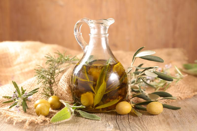 Carafe with olive oil. On wood background royalty free stock images