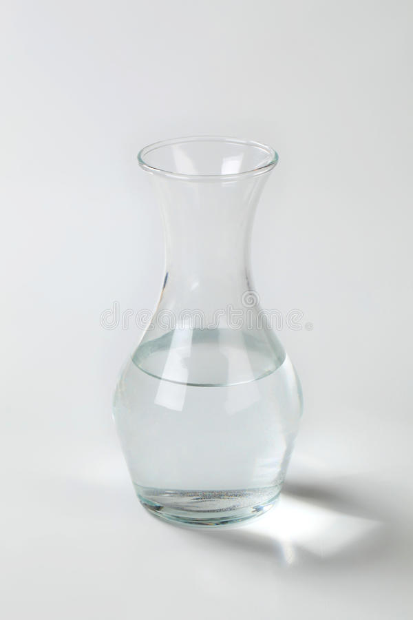 Carafe of water. Fresh water in glass carafe stock image