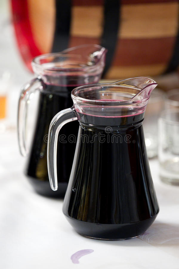 Carafe with wine. Two carafe with red wine royalty free stock images