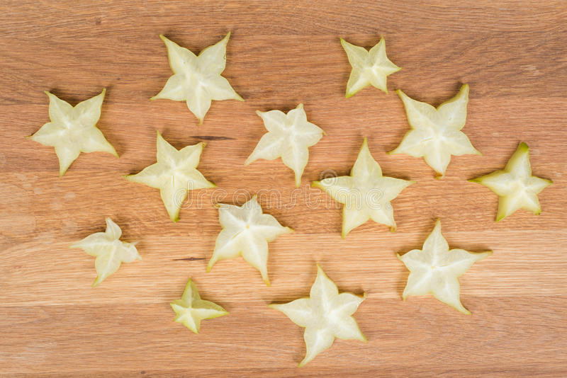 Carambolas - Starfruits on a wooden surface stock images