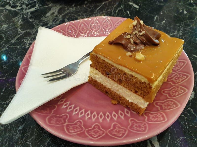 Caramel cake with almonds stock photo