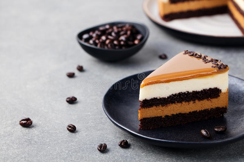 Caramel cake, mousse dessert on a plate Copy space stock photo
