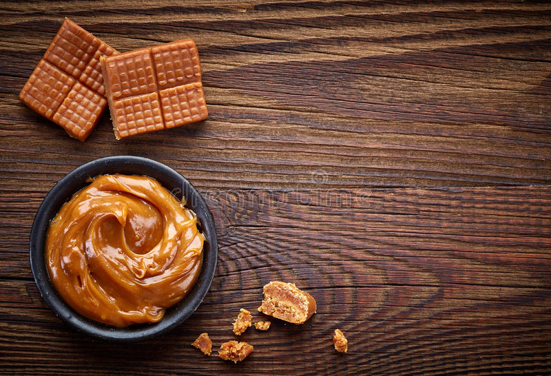 Caramel candies and sweet sauce royalty free stock photo