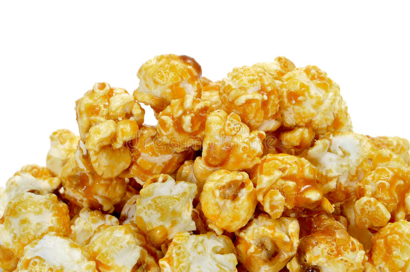 Caramel corn. A pile of caramel corn on a white background royalty free stock photo