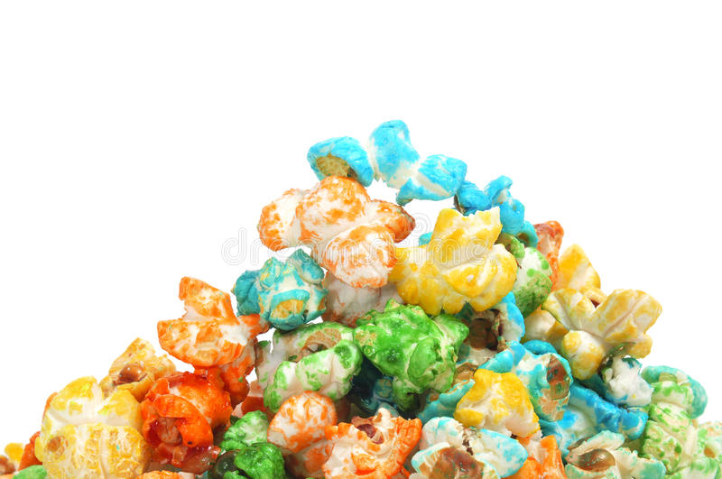 Caramel corn. A pile of caramel corn of different colors on a white background royalty free stock images