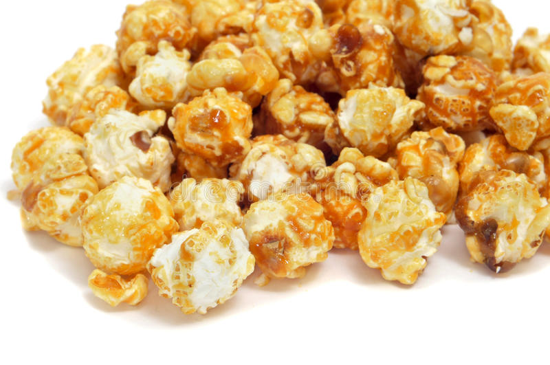 Caramel corn. A pile of caramel corn on a white background royalty free stock images
