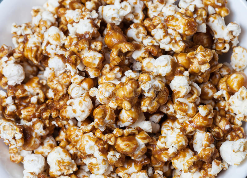 Caramel Corn Macro. Macro of baked caramel corn in dish royalty free stock photo