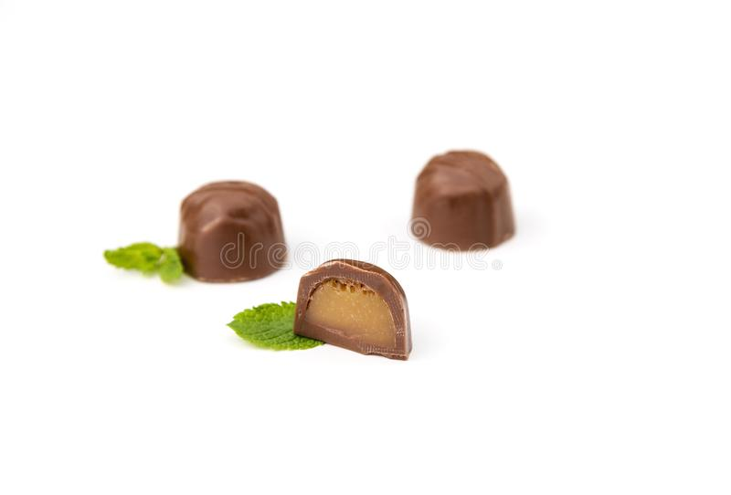 Caramel filled chocolates on white stock photos
