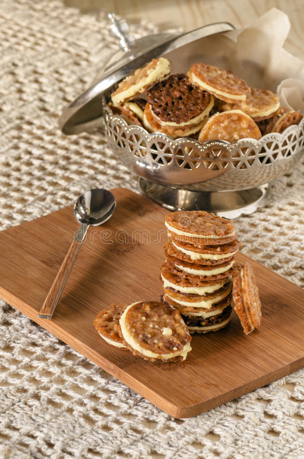 Download Caramel Florentines Cookies On A Wooden Cutting Board Stock Photo - Image of candy, italy: 39506182