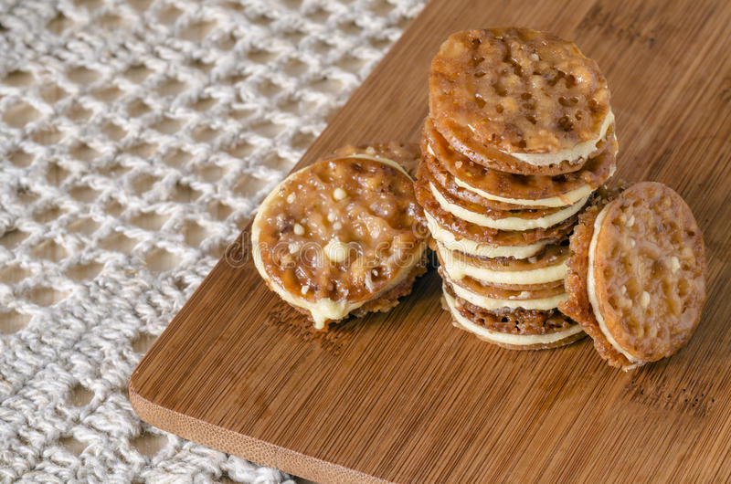 Download Caramel Florentines Cookies On A Wooden Cutting Board Stock Photo - Image of gourmet, confectionery: 39506190