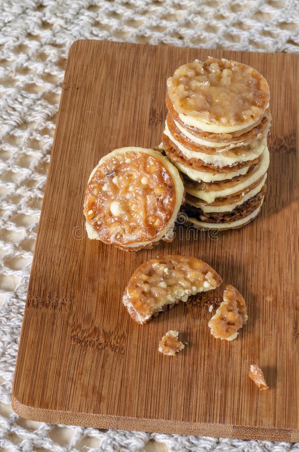Download Caramel Florentines Cookies On A Wooden Cutting Board Stock Photo - Image of imaginative, background: 39506194