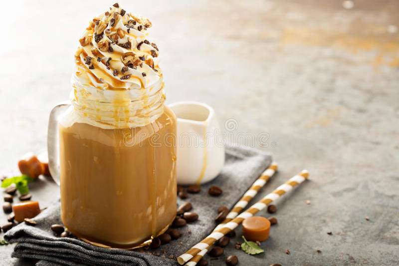 Caramel iced latte with whipped cream stock images