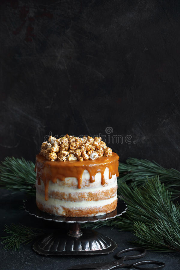 Caramel party cake with popcorn royalty free stock photography