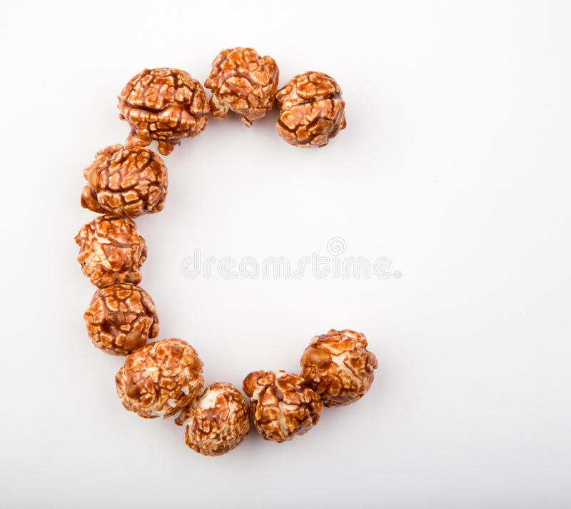 Caramel Pop Corn Alphabet white background. Studio quality stock images