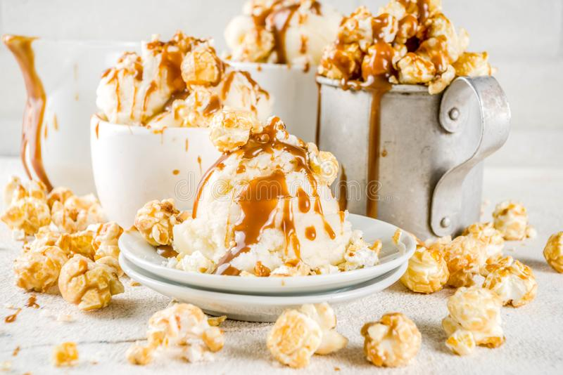 Caramel pop corn ice cream. Much of homemade caramel ad pop corn ice cream, on white marble ice cream copy space stock images