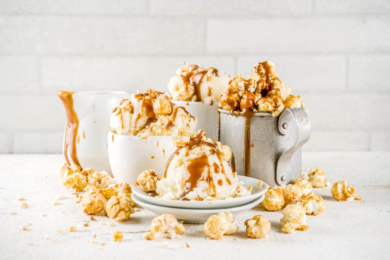 Caramel pop corn ice cream. Much of homemade caramel ad pop corn ice cream, on white marble ice cream copy space royalty free stock image